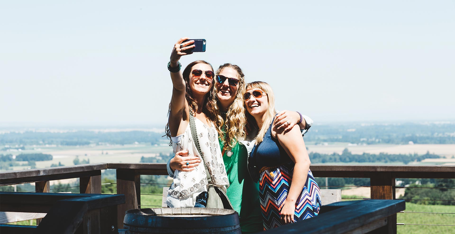 three young ladies taking a selfie