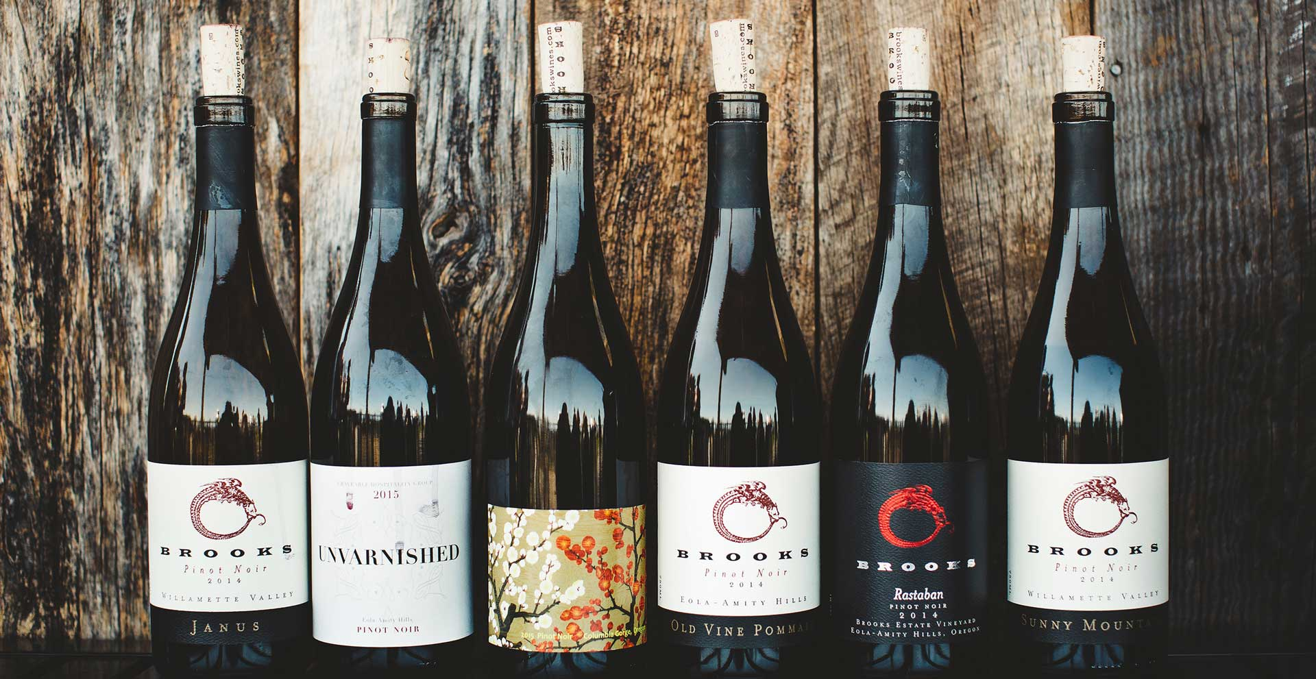 6 bottles of wine with wood background