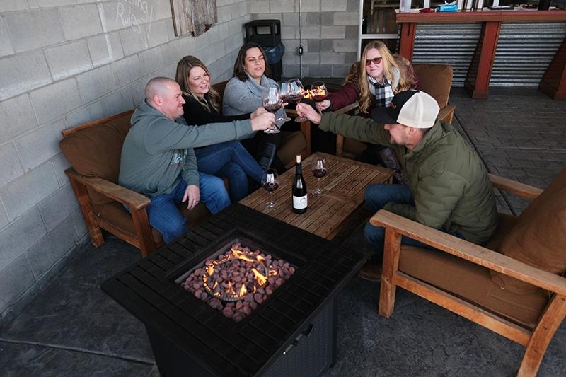 friends enjoying wine on deck